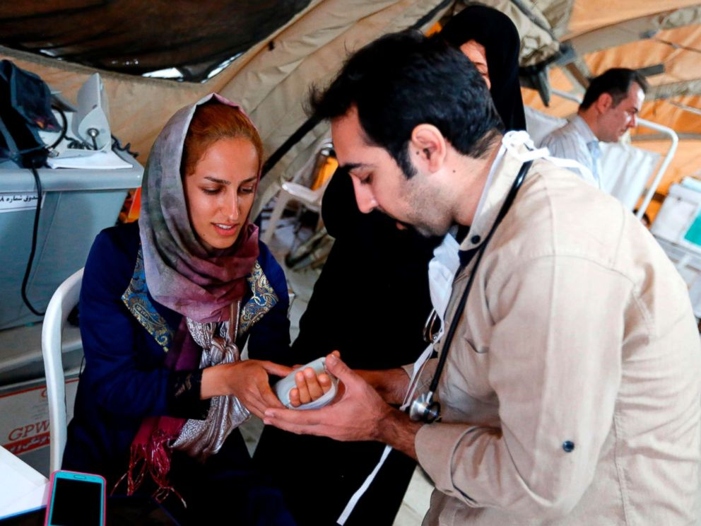 PHOTO: Medics attend to quake victims at a field hospital in the town of Sarpol-e Zahab in the western Kermanshah province near the border with Iraq on Nov. 14, 2017.