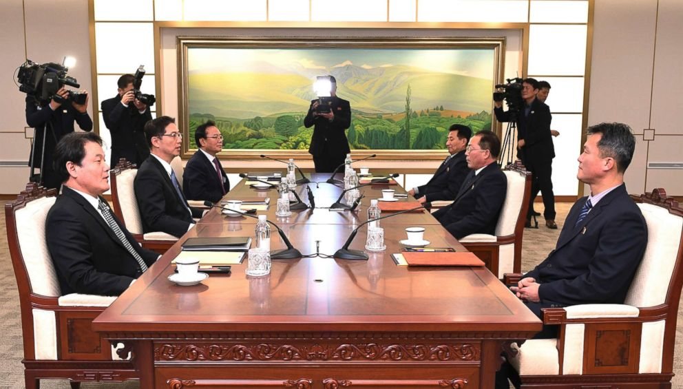 PHOTO: South Korean Vice Unification Minister Chun Hae-sung, center left, talks with the head of North Korean delegation Jon Jong Su during their meeting at Panmunjom in the Demilitarized Zone in Paju, South Korea, Jan. 17, 2018.
