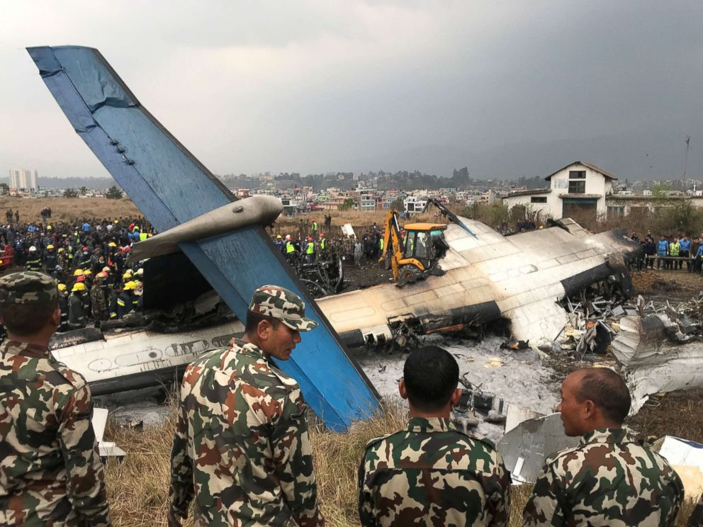 PHOTO: Wreckage of an airplane is pictured as rescue workers operate at Kathmandu airport, Nepal, March 12, 2018.