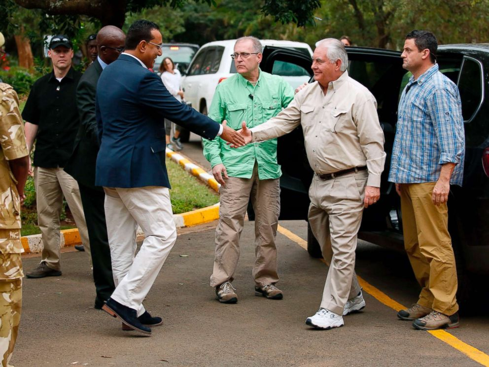 PHOTO: Kenyas Cabinet Secretary for Tourism Najib Balala (2-L) shakes hands with US Secretary of State Rex Tillerson (2-R) prior to a tour of the Kenya Wildlife Service in Nairobi, on March 11, 2018.