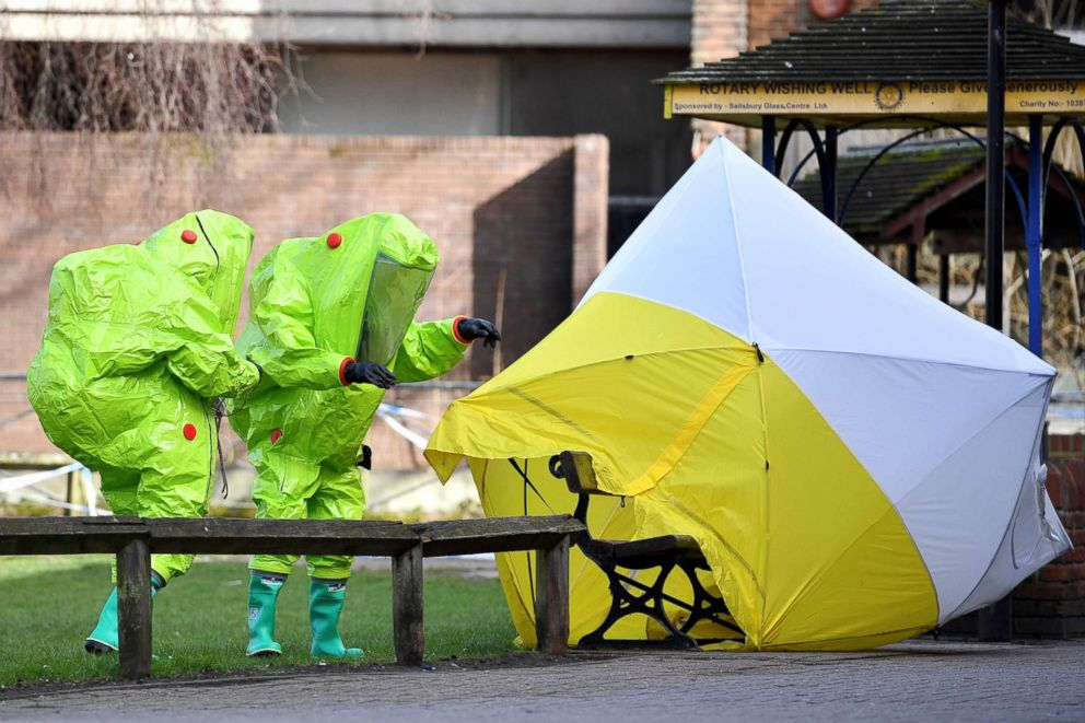 PHOTO: Members of the emergency services re-affix the tent over the bench where Russian spy Sergei Skripal and his daughter Yulia were found in critical condition at the Maltings shopping centre in Salisbury, England.