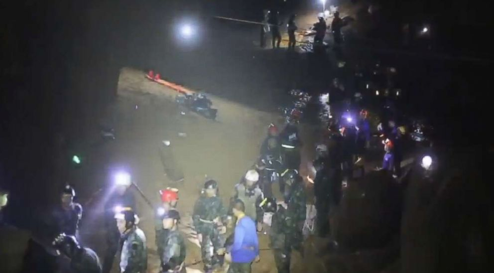 PHOTO: More than 30 rescuers form the two phalanx a bucket brigade to quickly pass the boys along to safety.