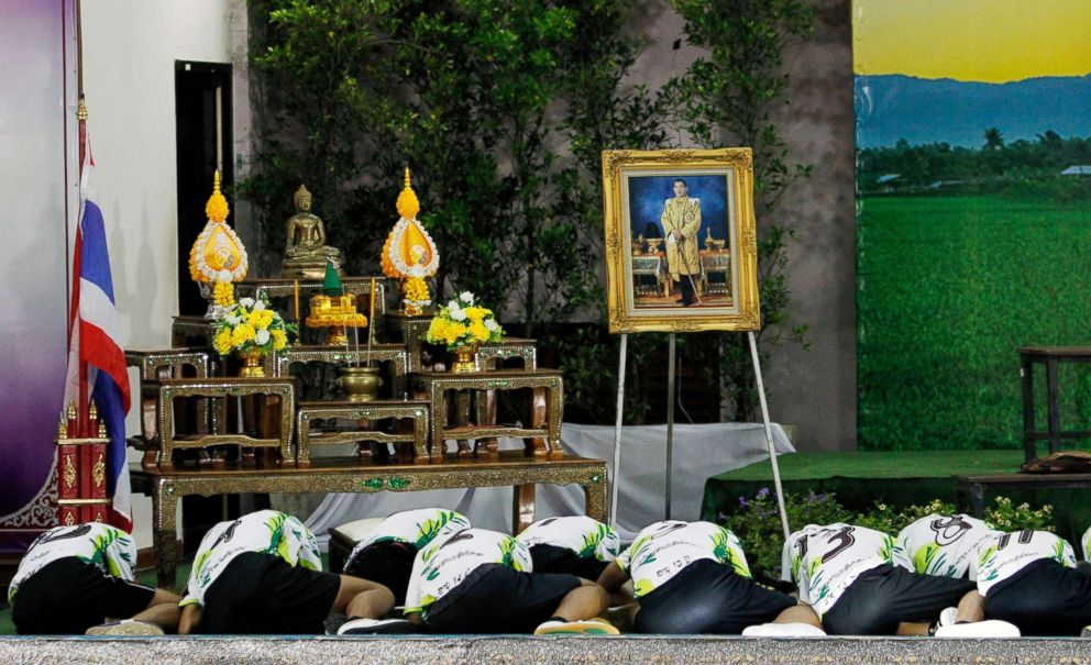 PHOTO: Thirteen rescued members of Wild Boar soccer team pay respects to a portrait of Thai King Maha Vajiralongkorn Bodindradebayavarangkun atthe Chiang Rai Provincial Administrative Organization in Chiang Rai, Thailand, July 18, 2018.