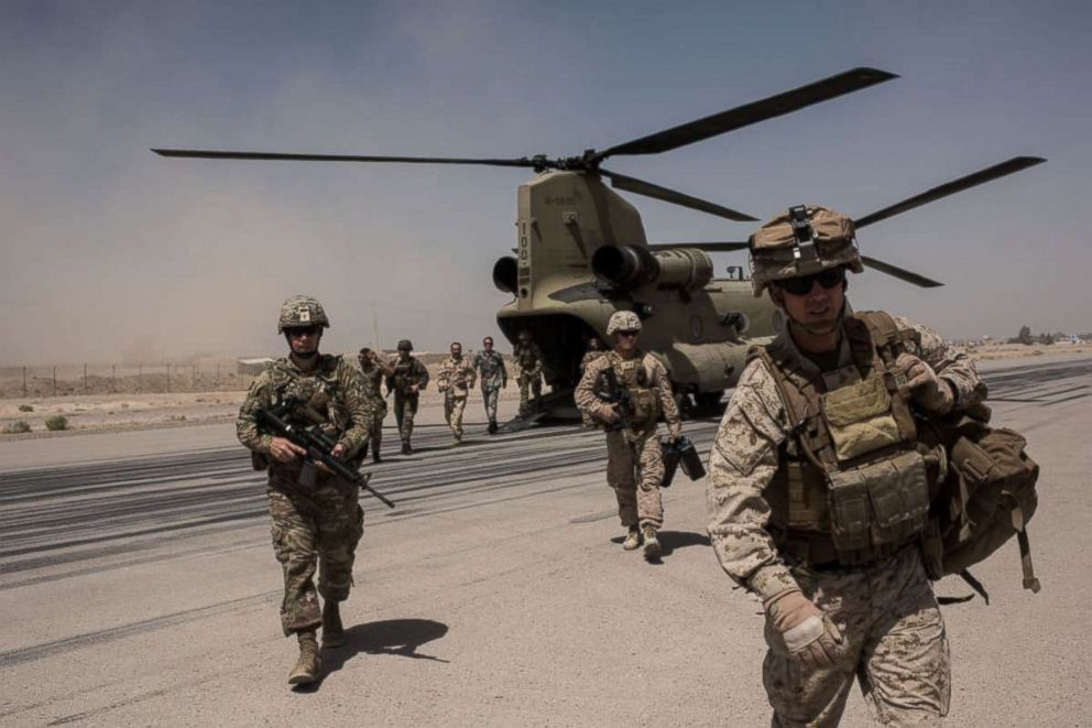 PHOTO: U.S. service members walk off a helicopter on the runway at Camp Bost on Sept. 11, 2017 in Helmand Province, Afghanistan.